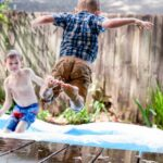 Two boys playing in inflatable pool